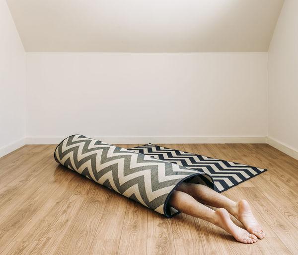 Boy sleeping on floor at home