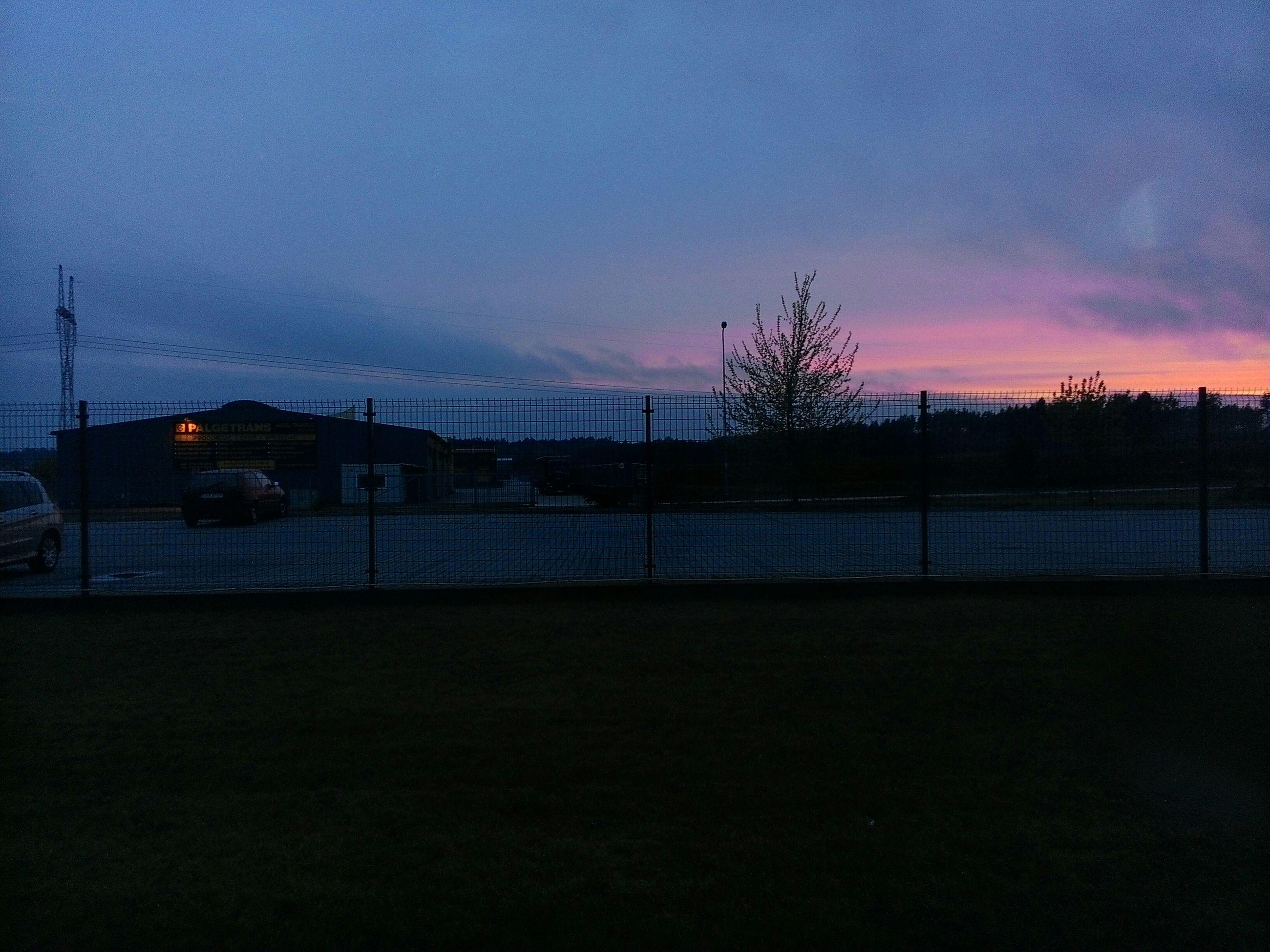 sunset, silhouette, sky, dusk, orange color, illuminated, dark, electricity pylon, tranquility, street light, tranquil scene, cloud - sky, scenics, nature, power line, landscape, outdoors, no people, beauty in nature, copy space