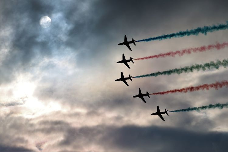 Air Display  Moon Red Arrows Air Display Aerobatics Air Vehicle Airplane Airshow Cloud - Sky Cooperation Fighter Plane Flying Low Angle View Mode Of Transportation Motion Nature No People on the move Outdoors Plane Skill  Sky Smoke - Physical Structure Speed Teamwork Transportation Vapor Trail