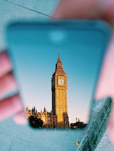 London Reflection Westminster Architecture Bigben Building Exterior Built Structure Clock Close-up Day Human Hand IPhone Nautical Vessel Old Outdoors Parliment Sky Time Travel Destinations Water Paint The Town Yellow Colour Your Horizn