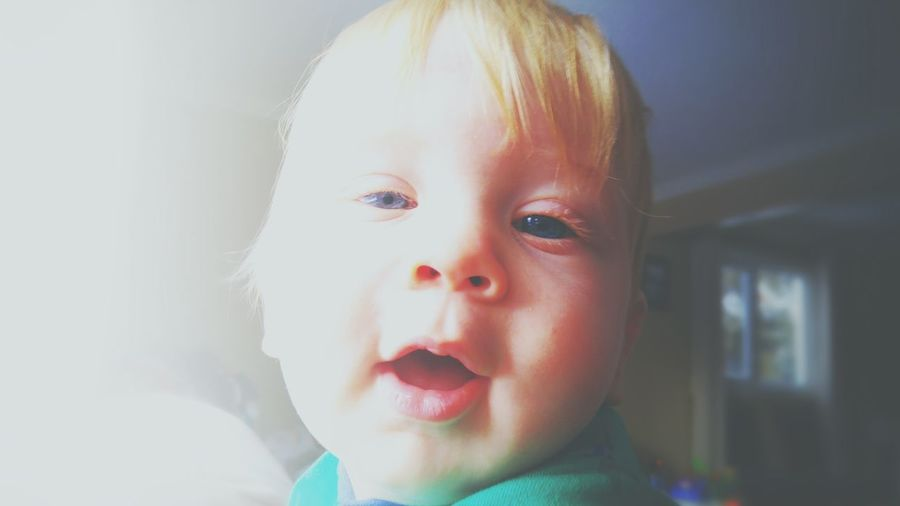 Close-up portrait of cute baby at home