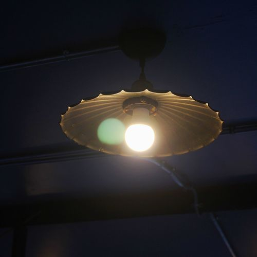 Low angle view of illuminated light bulb