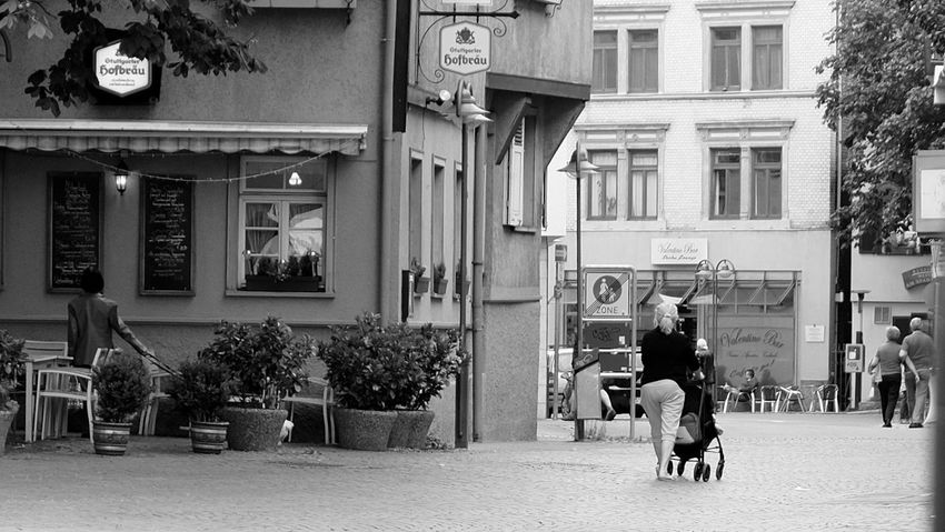 Three life phases Development Adult Retirement Adults Only Architecture Blackandwhite Building Exterior City City Life Day Fujifilm_xseries Men Mother & Daughter Mother And Child Outdoors People Street Streetphotography Monochrome Street Photography Coffee Time A - Straßenviews