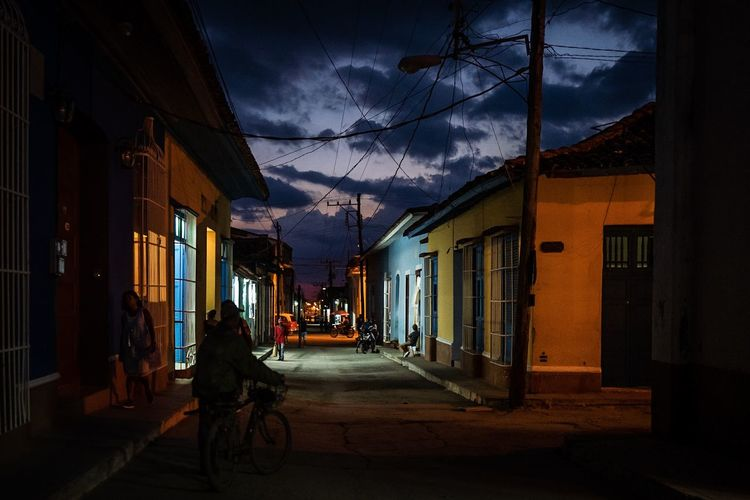 View of street amidst buildings at night