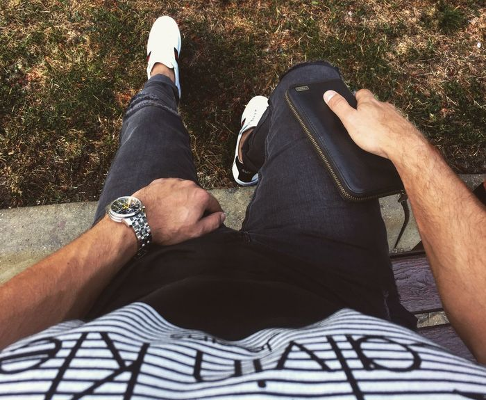 Human Leg Low Section Human Body Part Two People Men Personal Perspective Real People Leisure Activity Day High Angle View Only Men Lifestyles Outdoors Human Hand Togetherness Grass Close-up Adult Adults Only People