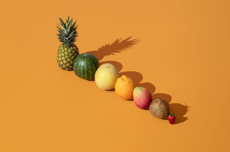 Close-up of bananas against orange background