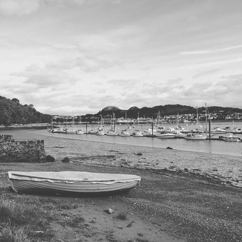 View of conwy harbour in wales Beach Water Sea Sky Sand Outdoors Transportation Nautical Vessel Tranquility Moored Conwy Conwy Harbour Conwy, Village In North Wales Conwy Estuary Wales Wales❤ Wales UK Blackandwhite Black And White Black & White IPhoneography Black And White Friday