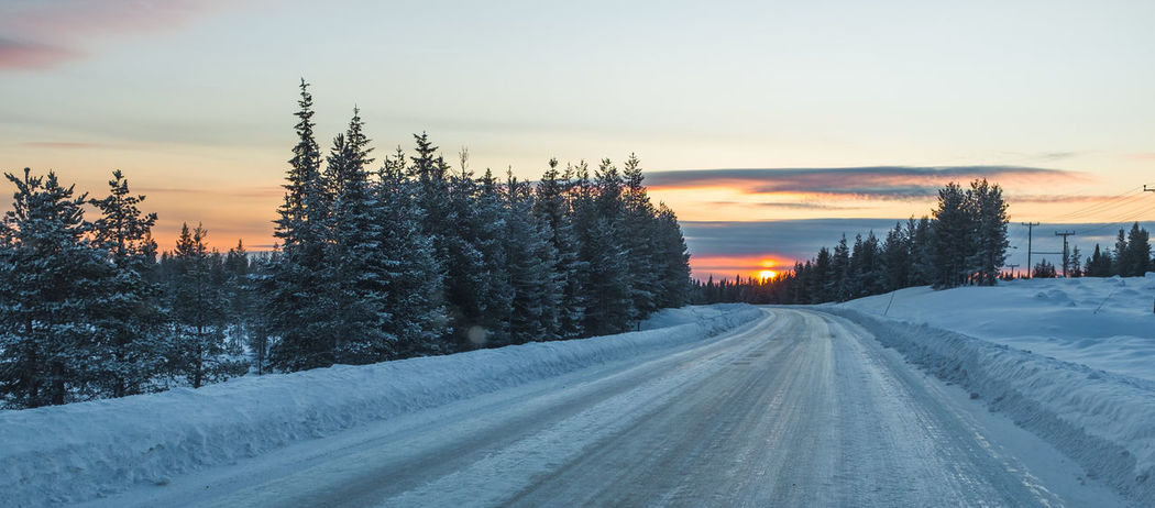 Icy, snowy road through the snow covered forest at sunset Cold Days Cold Temperature Cold Weather Cold Winter ❄⛄ Drive Carefully Driving Endless Road Forest Icy Icy Wonderland Landscape Road Roadscenes Rural Season  Snow Snow Covered Snowy Road Sunset Tree Vanishing Point Winter Winter Winter Wonderland Wintertrees
