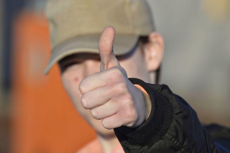 Close-up of man gesturing thumbs up