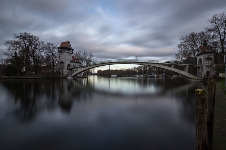 Berlin Treptower Park Berlin Insel Der Jugend Treptower Park Architecture Bare Tree Bridge - Man Made Structure Building Exterior Built Structure City Cloud - Sky Connection Covered Bridge Day Nature No People Outdoors Reflection River Sky Tree Water