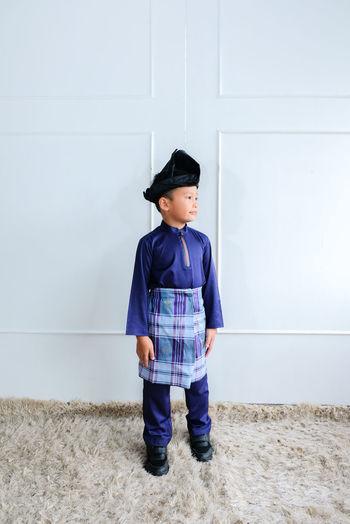 Muslim kids portrait with baju melayu isolated on white background.hari raya aidilfitri concept