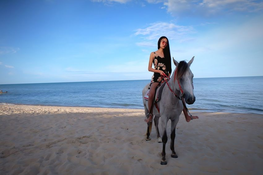 Women riding Beach Land Sea Sky Horizon Over Water Horizon Water Beauty In Nature Real People Sand Day Scenics - Nature Nature One Person Animal Themes Full Length Domestic Animals Domestic Animal Outdoors