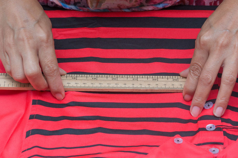 Hand on marking measurement t-shirt Adult Casual Clothing Close-up Finger Hand High Angle View Human Body Part Human Hand Indoors  Instrument Of Measurement Lifestyles Measuring Midsection Number One Person Real People Red Striped Tape Measure Women