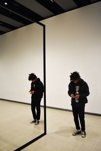 Art Gallery Reflection Mirror Full Length Two People Real People Standing People Indoors  Lifestyles Men Leisure Activity Architecture Side View Built Structure Silhouette Wall - Building Feature