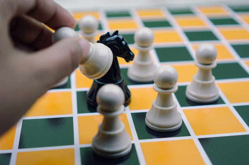 High angle view of man playing on chess