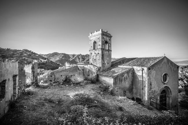 The Week On EyeEm Architecture Abandoned Building Exterior Old Ruin Place Of Worship Outdoors No People Bell Tower Savoca, Sicily Religion Sicily Sicilia Thegodfather Italy Italia Church Sunset Landscape Your Ticket To Europe Connected By Travel Black And White Friday