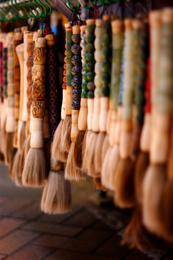 Close-up of multi colored brushes in market