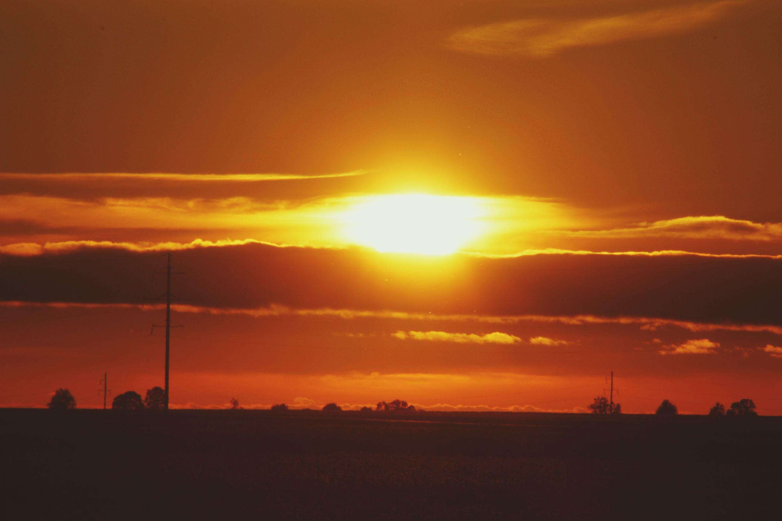 sunset, silhouette, orange color, sun, scenics, sky, beauty in nature, tranquil scene, tranquility, landscape, idyllic, nature, cloud - sky, cloud, dramatic sky, outdoors, no people, back lit, majestic, dark, sunbeam, outline, non-urban scene, remote, horizon over land