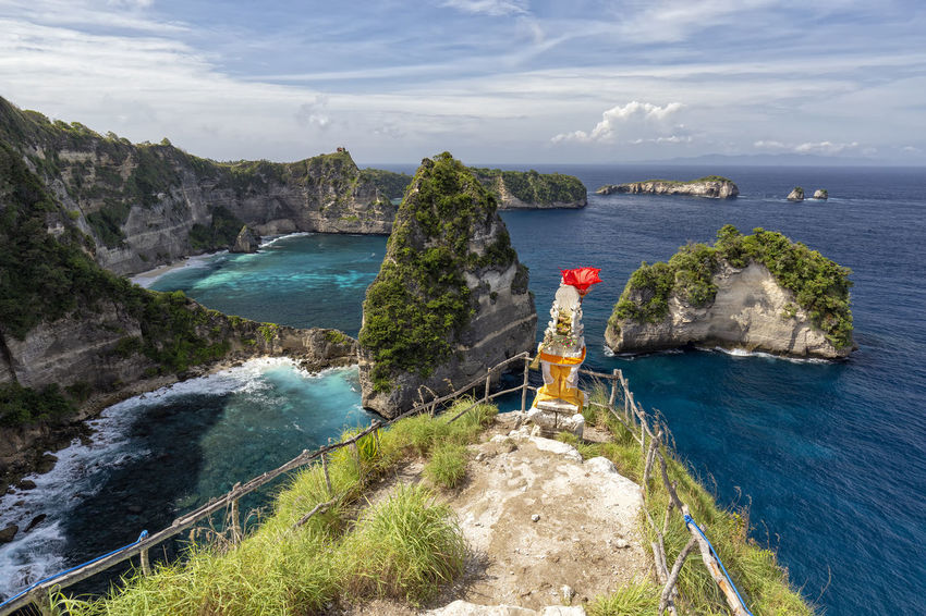 Rugged and beautiful coastline on a small part of Nusa Penida, a small island near Bali. ASIA Atuh Beach Bali Diving Hindu INDONESIA Indonesian Nusa Batupadasan Shrine Tourist Travel Ampoak Atuh Balinese Beach Destination Klungkung Landscape Lebah Nusa Batumategan Nusa Penida Pejukutan Raja Lima Tourism Tropical