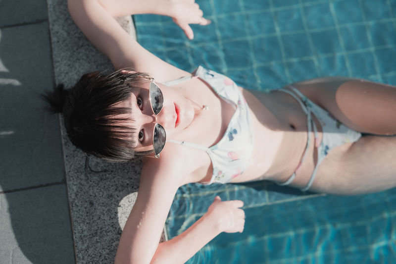 High angle portrait of woman in swimming pool