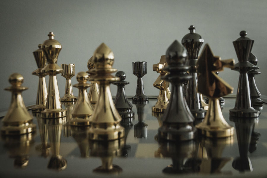 golden and silver chess pieces on a chessboard Checkerboard Chekker Chess Chess Board Chess Game Chess Pieces Chess Pieces Lined Up Chess Set Chess-men Chessboard Chessgame Chessmen Game Of Chess Gold And Silver  Pawns