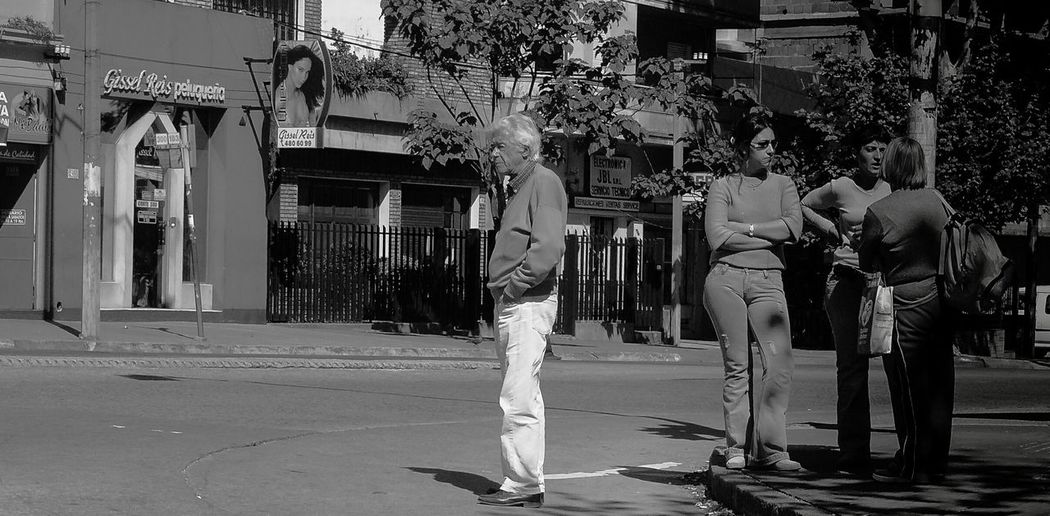 'Where is my shade?'. . . Uruguay Gossiping Heat Wave Blackandwhite Photography Pedestrian Young And Old Street Shadows Light And Shadow Negative Space
