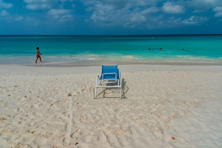 Beach Beauty In Nature Chair Day Full Length Horizon Over Water Leisure Activity Men Nature One Person Outdoors People Real People Rear View Sand Scenics Sea Shore Sky Tranquil Scene Tranquility Vacations Water