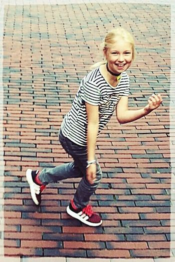 Happy daughter! Smiling Looking At Camera Portrait Happiness Childhood One Person Full Length Outdoors Joy Child Girl City Blond Hair Running Moving The Week On EyeEm