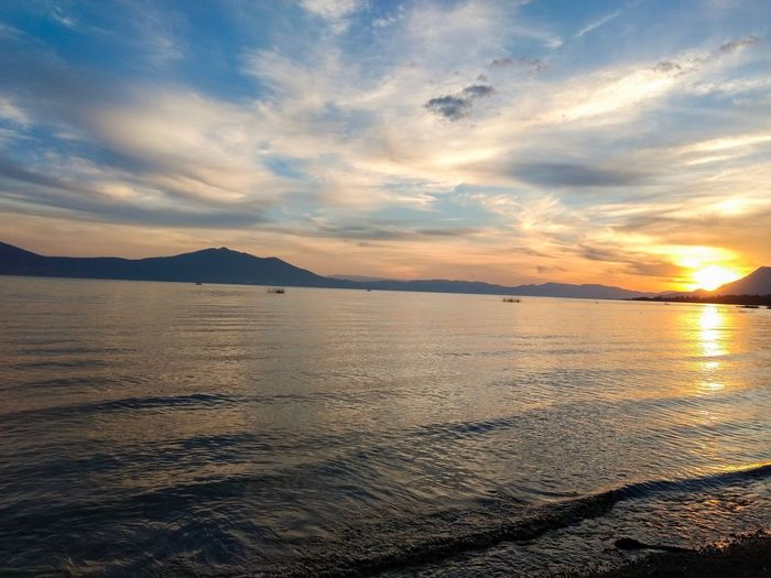 Sunset in Chapala Water Sky Sea Scenics - Nature Beauty In Nature Sunset Cloud - Sky Tranquility Tranquil Scene Land Nature Idyllic Reflection Sunlight No People Non-urban Scene Sun Outdoors Horizon Over Water