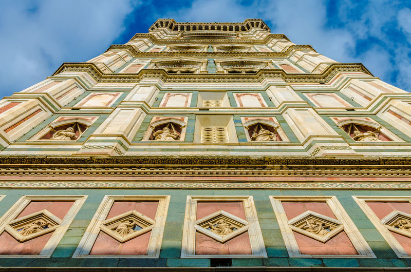 Giotto's Campanile or Bell Tower that twins the Duomo in Florence. Florence Cathedral Giotto Di Bondone Giotto's Bell Tower Piazza Del Duomo Renaissance Toscana Architecture Art Bell Tower Building Exterior Built Structure Cloud - Sky Florence Giotto Giotto Campanile Looking Up Low Angle View Marble Polychrome Religion Travel Destinations