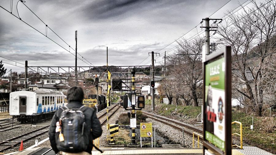 Train Train - Vehicle Train Station Track Railway Traffic Lights One Person Day Cold Temperature City Sculpture Statue Art And Craft Sky Architecture Cloud - Sky Built Structure Railroad Station Platform Public Transportation Rail Transportation Railroad Station Railroad Platform