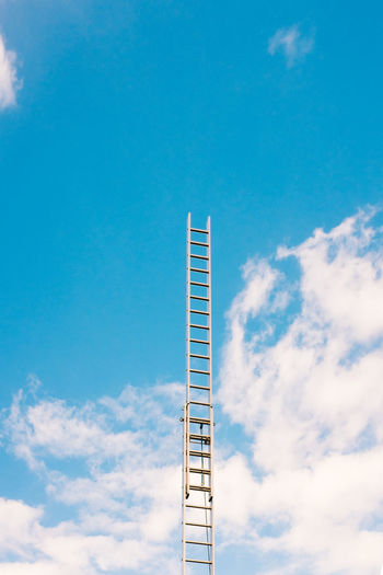 Low angle view of ladder against sky