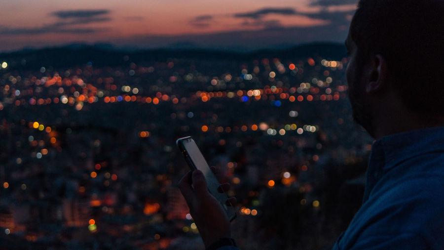 High angle view portrait of illuminated cityscape