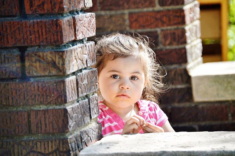 Brick Wall Childhood One Person Portrait Looking At Camera Front View Child Outdoors Headshot Leaning Day Girls Children Only Close-up People Twoyearold  2017