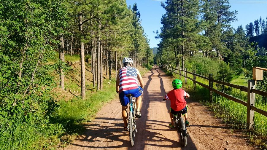 Biking the George B. Mickelson bike trail Father And Daughter Tranquil Scene Fatherhood  Outdoors South Dakota Hill City