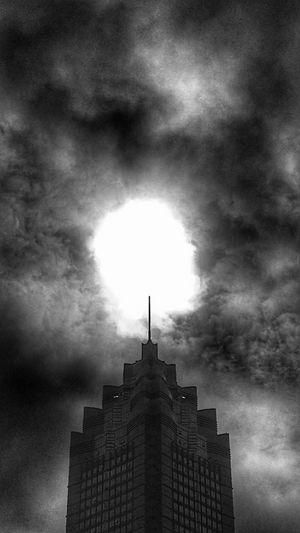 Obelisk Blackandwhite Urbanphotography Monochrome Photography Architecture Cloud - Sky Sky Built Structure Building Exterior Low Angle View Outdoors Light In The Darkness Light And Dark Decisive Moment Sunlight Dark Clouds Smog Tower Top Energy End Of The Day Lightning Needle