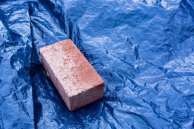 High angle view of brick on tarpaulin