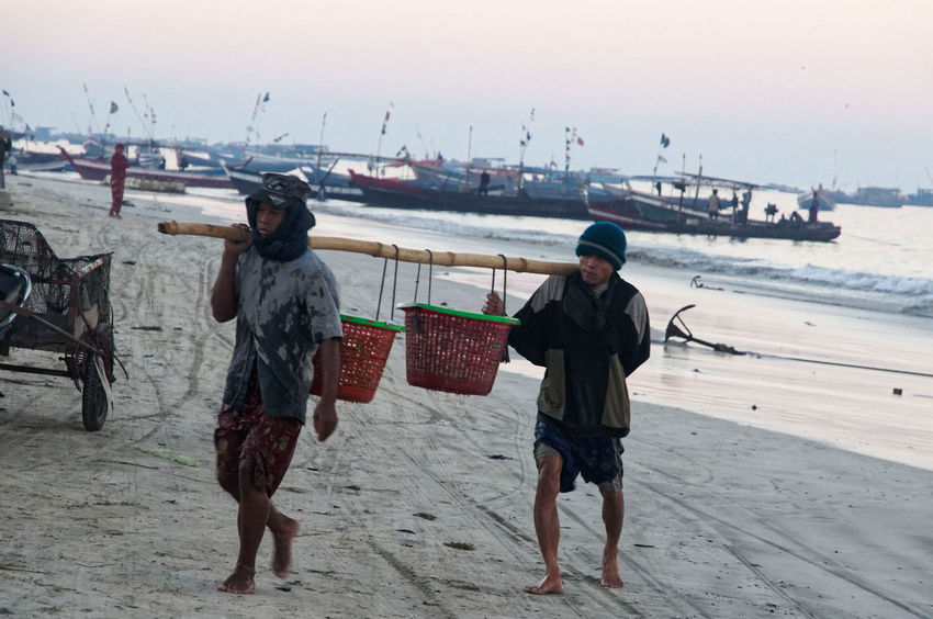 These two men are probably selling their load later on the market Rakhine State Beach Boys Clear Sky Day Fishing Full Length Horizon Over Water Lifestyles Myanmar Nature Nautical Vessel Outdoors People Real People Sand Sea Shore Sky Standing Togetherness Two People Water Young Adult