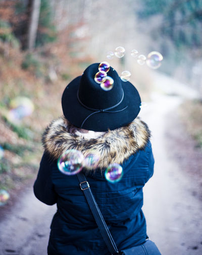 Adult Adults Only Aligned Autumn Cold Day One Person Outdoors People Portrait Real People Rear View Soap Bubbles Warm Clothing