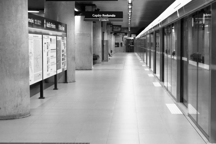 Black And White b&w Blackandwhite Black&white Black And White Collection  Blackandwhitephoto Corridor Architecture Built Structure Text Communication Indoors  The Way Forward No People Day MetroSP Subwayphotography Subway People Subway Station Metro Station City Standing