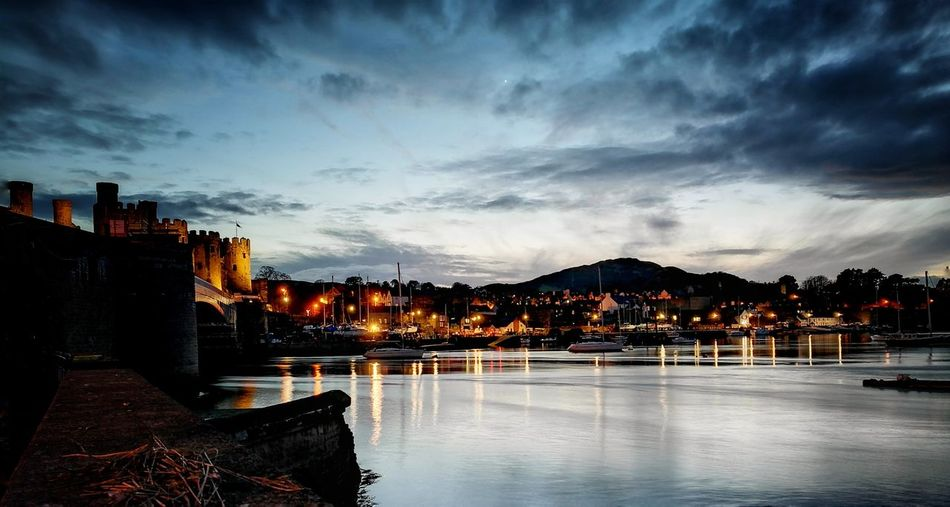 Conwy water front Dusk Illuminated Reflection Night Architecture Sunset Outdoors Bridge - Man Made Structure Water Tonal Contrast Conwy Castle Conwycastle HuaweiP9 Tonalcontrast Conwy, Village In North Wales Wales UK Huawei P9 Leica Leicacamera Walesonline Conwy Boats And Water Boat Landscape Cloudsporn Clouds And Sky