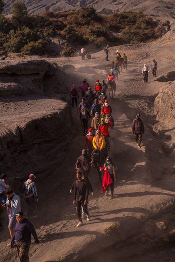 High angle view of people walking on rocks