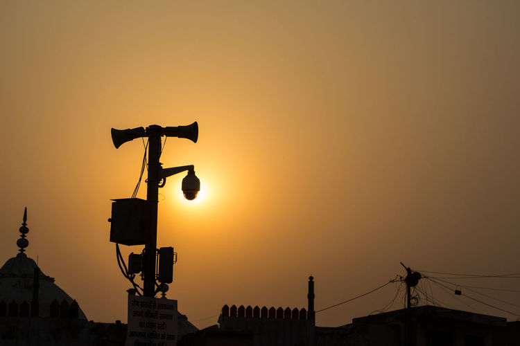 sun behind CCTV pole in old Delhi, Delhi, India Background Cctv City View  Contrast Delhi Indiapictures Orange Color S Silhouettes Silhouettes Of A City Sun Sunandsky