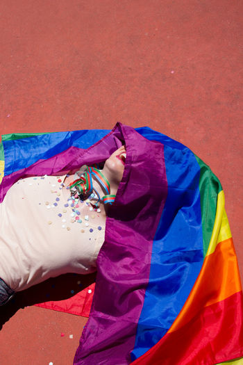 Young Woman With Rainbow Flag Lying Down