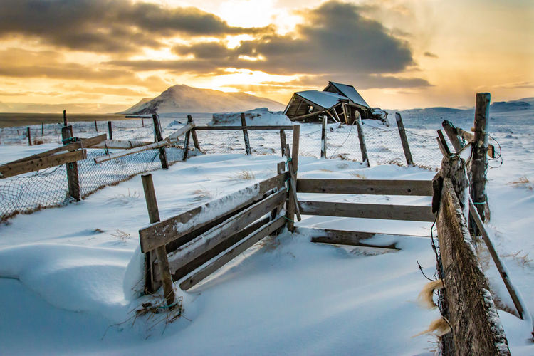 Ice cold Jason Gines Beauty In Nature Cloud - Sky Cold Cold Temperature Covering Frozen Idyllic Land Nature No People Scenics - Nature Sky Snow Snowcapped Mountain Sunset Tranquil Scene Tranquility Water Winter Wood - Material Wooden Post