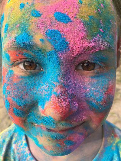 Close-up portrait of a child with face paint