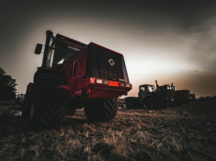 Tractor on agricultural field against sky