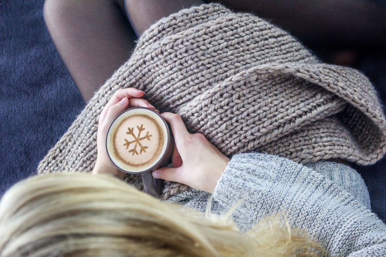 Coffee One Person Adults Only One Woman Only Only Women People Sweater Human Body Part Warm Clothing Adult Close-up Indoors  One Young Woman Only Top View Winter Indoors  Indoors  One Young Woman Only Indoors  Cup Rest Sofa Top View Women Bed Young Adult Day First Eyeem Photo Girl