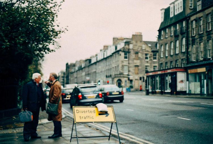 Diverted Traffic Argument Pointing Street Photography Street Businessmen Edinburgh George Street Road Traffic