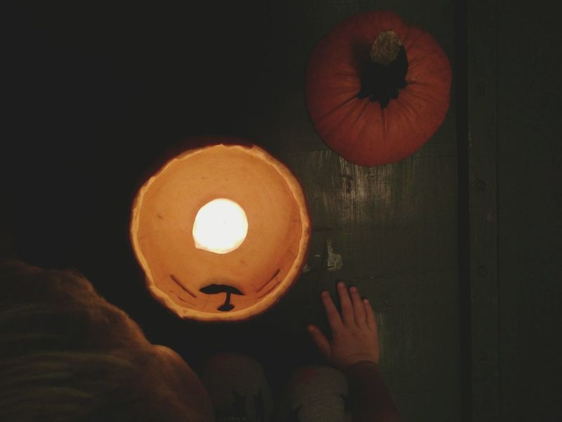 Pumpkin Lantern Illuminated Human Hand One Person Candle Light Night Photography Kids Hands Candlestick Pumpkin Carving Time Fall Season Image Pumpkin Carving Orange Color Multi Colored Childhood Fall Season Pumpkins Pumpkin Head